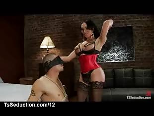 Tranny in lingerie gets blowjob by bound guy